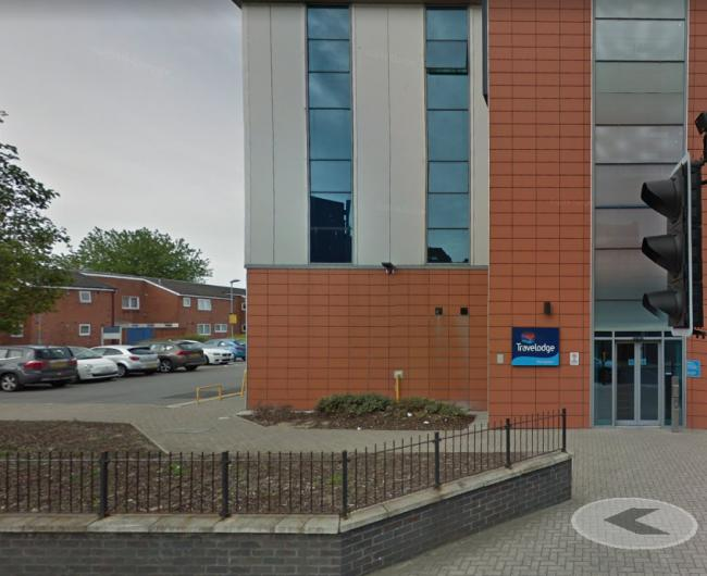 Woman rushed to hospital from Travelodge after being stabbed in legs