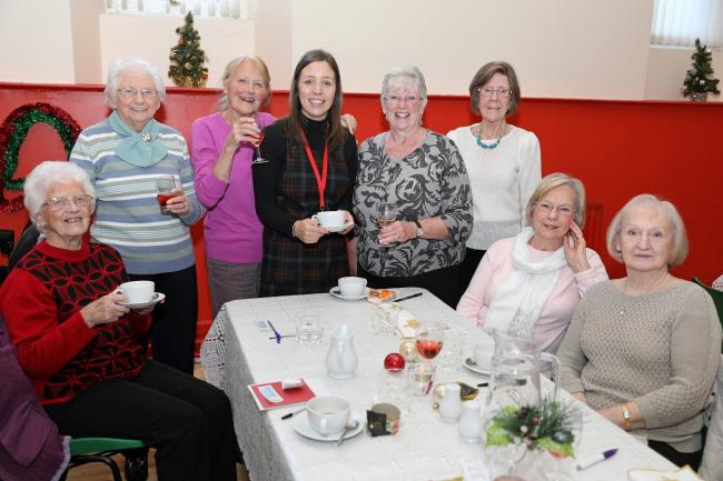 Jessica Wray, from Karbon Homes, with St Patrick's Lunch Club volunteers at the festive lunch held to mark the end of successful year of community lunches. The club was started in January with a £1,000 grant from the housing provider