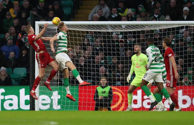 Sam Cosgrove (left) heads home against Celtic earlier this month - Middlesbrough are keen to sign the striker in January, but Aberdeen will drive a hard bargain