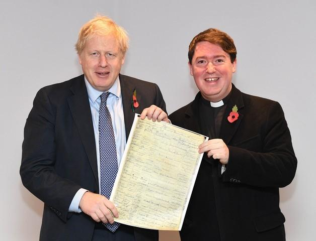 Boris Johnson receives his great-great-great-grandfather's baptismal entry from the Rev Matthew Firth of St Cuthbert's Church, Darlington