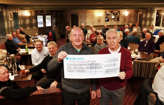 Gary Clasper handed Geoff Sheldon from the MNDA a cheque            Picture: CHRIS BOOTH