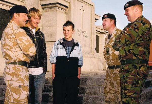 ON SITE: From left, Corporal Richard Meharg, local youngsters Sam Patten and Brad Atkinson, Corporal Thaddeaus Greenwood and Lance Corporal Daniel Wilkinson