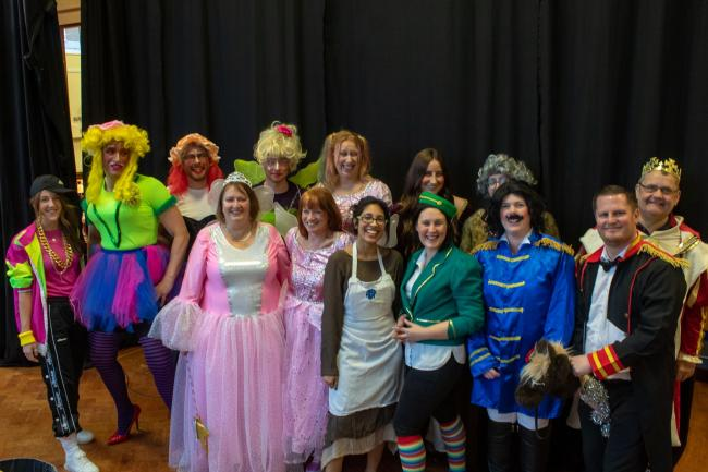The staff cast of Longfield's Cinderella backstage before curtain-up