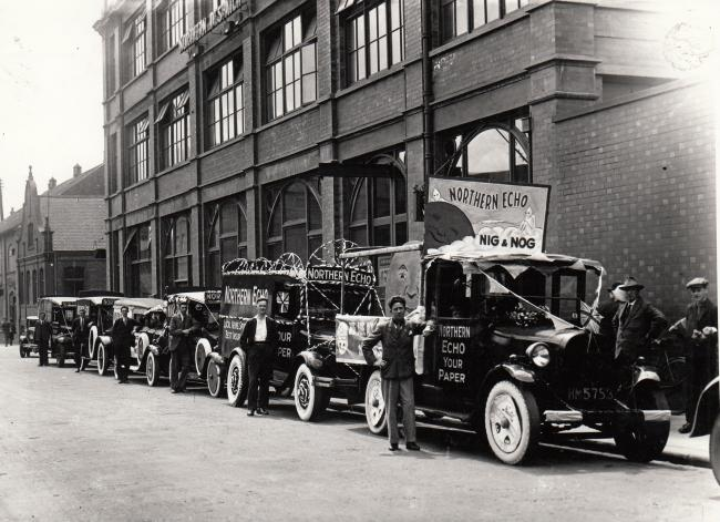 Vehicles outside The Northern Echo office dressed up for a Nig Nog Club fundraiser in the 1930s