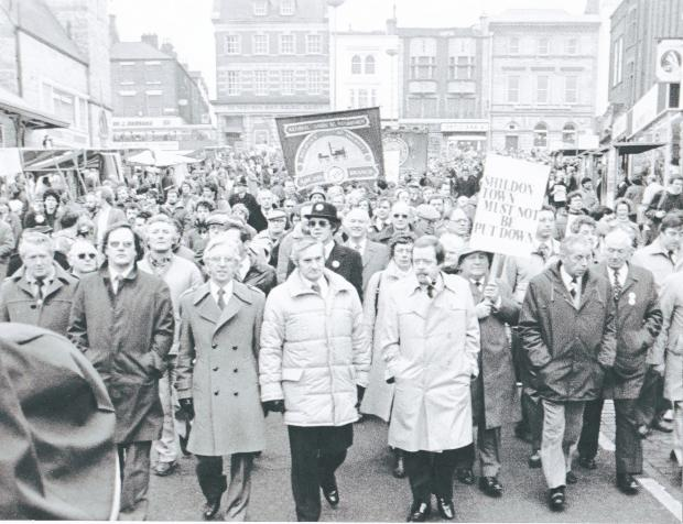 The Northern Echo: MARCHING ON DARLINGTON: The Shildon protest in Tubwell Row, with High Row behind, on March 13, 1983. Derek Foster MP leads the way with, on his right, the Labour candidate in the forthcoming Darlington by-election, Ossie O'Brien.