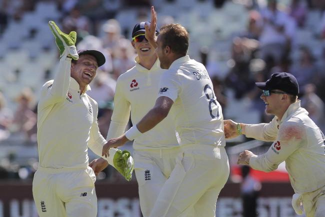 Stuart Broad and the England team celebrate the wicket of Rassie van der Dussen during day five of the second Test between South Africa and England (Picture: AP Photo/Halden)