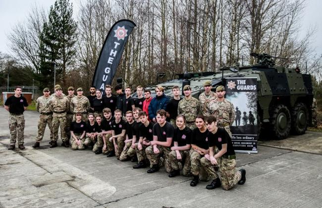 Members of the Scots Guars Regiment and those on the YH Military preparation course based in darlington in front of the new Boxer wheeled armoured vehicle Picture: SARAH CALDECOTT