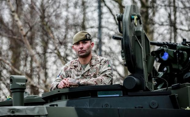 The Northern Echo: Lance Sgt Gibb of the Scots Guards Regiment in the new Boxer wheeled armoured vehicle at Catterick Garrison. Picture: SARAH CALDECOTT