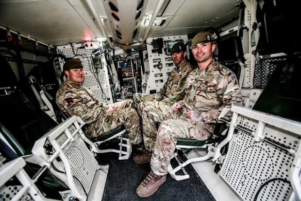 The Northern Echo: Lance Corp Golightly, Lance Corp Dixon and Lance Sgt Gibb of the Scots Guards Regiment in the new Boxer wheeled armoured vehicle at Catterick Garrison. Picture: SARAH CALDECOTT