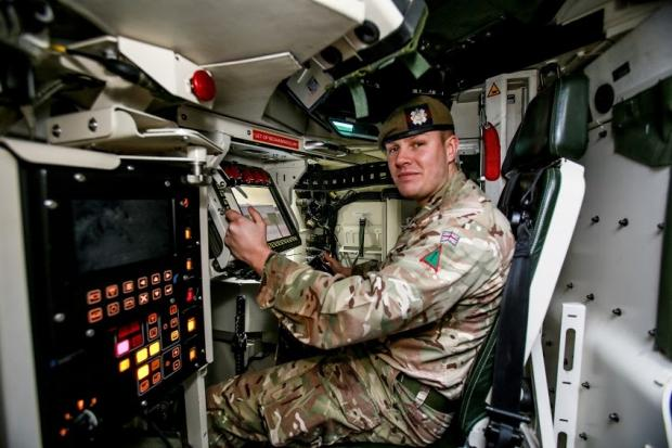 The Northern Echo: Lance Corp Dixon in the new Boxer wheeled armoured vehicle at Catterick Garrison. Picture: SARAH CALDECOTT