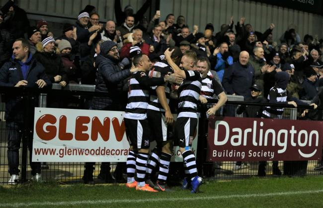 Darlington celebrate with Omar Holness after he scored the winning goal in Wednesday's win against Solihull Moors in the FA Trophy. Picture: CHRIS BOOTH