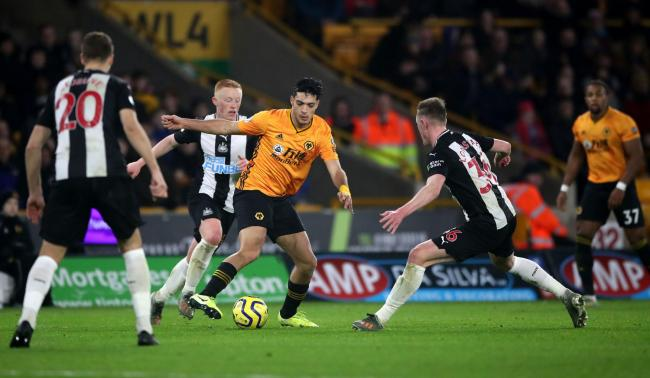 Newcastle United's Matthew Longstaff, Wolverhampton Wanderers' Raul Jimenez and Newcastle United's Sean Longstaff in action during the Premier League match at Molineux, Wolverhampton. PA Photo. Picture date: Saturday January 11, 2020. See PA s