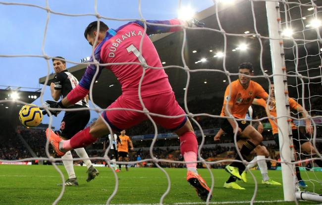 Martin Dubravka makes a point-blank save from Raul Jimenez's header (Picture: Nick Potts/PA Wire)