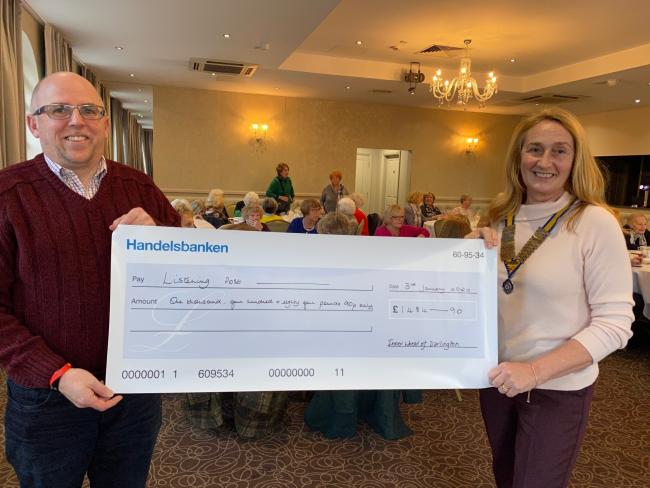 Darlington Inner Wheel President Lynne Waterfall-Brown presents the cheque to Martin Stand from Listening Post