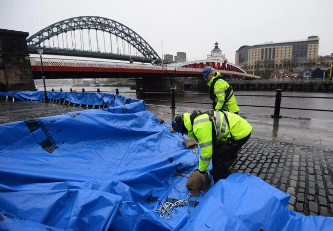 Barriers being put up at Newcastle Quayside  following fears of a tidal surge Picture: North News and Pictures