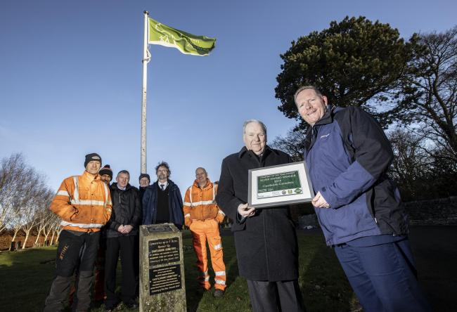From left, David Wales, gardener; Michael Simmons, gardener; Graham Harrison, bereavement services manager; Anthony Halliday, gardener; Ian Ramsay, bereavement officer; Phil Toole, gardener; Cllr Brian Stephens; Ian Hoult, neighbourhood protection manager