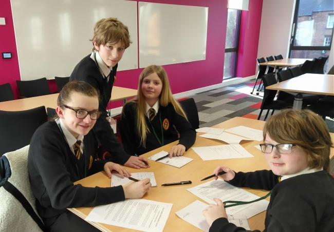 Year 7 and 8 students working on the accounting challenge at the Discovery Day at The University of Leeds