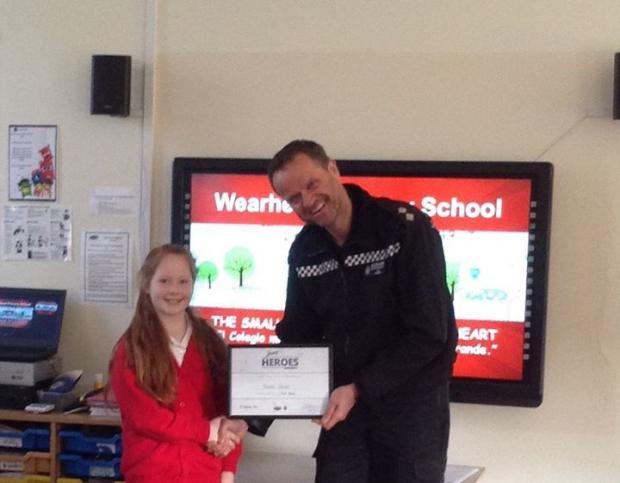 The Northern Echo: Inspector Ed Turner hands Phoebe her award