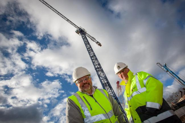 Project directors Ian Beaumont, left, and Michael Rutherford in front of the 68-metre tall crane at the site of the Milburngate development in Durham city centre