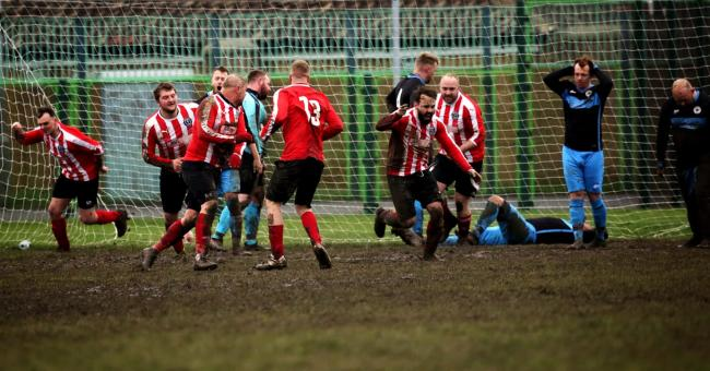 Joy and despair etched on faces in fantastic football Sunday league photo