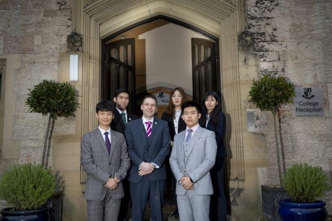 Myddelton College headmaster Andrew Allman with students from China, from left, Albert Gao, Martin Wong, Cynthia Guw, Kenneth Zou and Anna Zhang