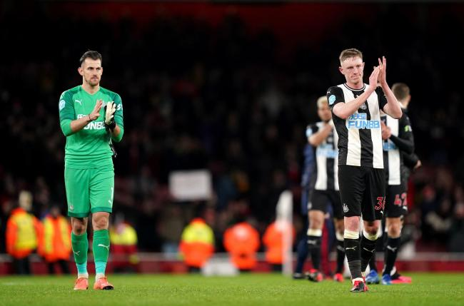 Newcastle United goalkeeper Martin Dubravka (left) and Sean Longstaff applaud the fans after the final whistle during the Premier League match at The Emirates Stadium, London. PA Photo. Picture date: Sunday February 16, 2020. See PA story SOCCER Arsenal.