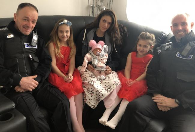 PC Dennis Lewis, Natalie Behakova, Lucie Behakova with baby Amilie, Sofia Behakova and PC Martin Lindsley.