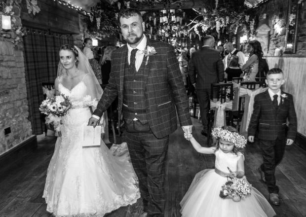The Northern Echo: Emma and Mark Stanger on their wedding day with son Leighton and daughter Jessie