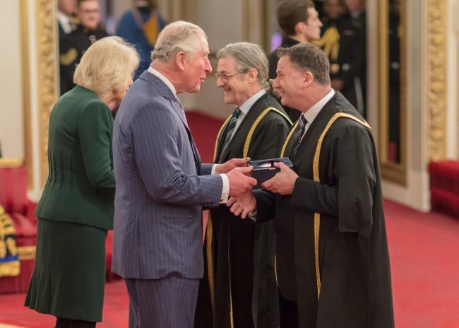 John Roach, principal of South Shields Marine School, and Andrew Watts, chair of Tyne Coast College receiving the Queen's Anniversary Prize award in the Ballroom at Buckingham Palace from TRH The Prince of Wales and The Duchess of Cornwall