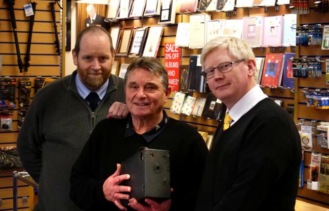 Retiring photographic shop owner Brian Eagles, centre, with Stuart Lauderdale and Peter Rickerby, who have been praised for their loyal service