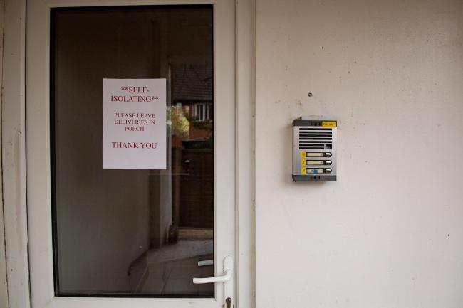 A stock photo of a self-isolation sign left outside a property.        Picture: JACOB KING/PA WIRE