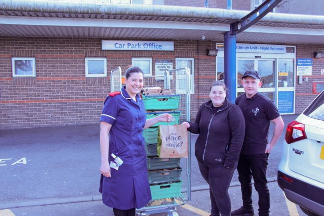 Staff from North Tees and Hartlepool NHS Foundation Trust taking delivery of 100 meals from Teesside Park Nandos today