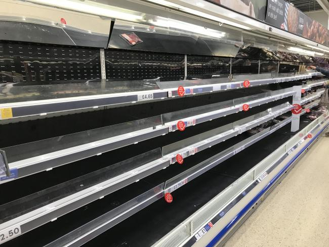 Empty shelves in a Tesco Extra in Worthing, West Sussex, the day after Prime Minister Boris Johnson called on people to stay away from pubs, clubs and theatres, work from home if possible. Picture: Michael Drummond/PA Wire