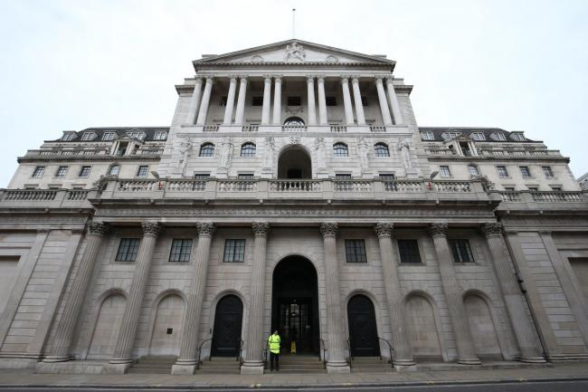A lone security guard stands outside the Bank of England, in the City of London, as the UK's coronavirus death toll  reached 144 as of 1pm on Thursday, with around four in 10 of all deaths so far in London. PA Photo. Picture date: Friday March 20, 2