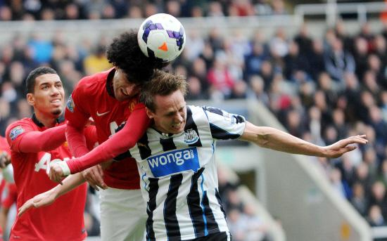 Newcastle United's Luuk De Jong and Manchester United's Marouane Fellaini during the Barclays Premier League match at the St James' Park, Newcastle.  Editorial use only. Maximum 45 images during a match. No video emulation or promotion as '