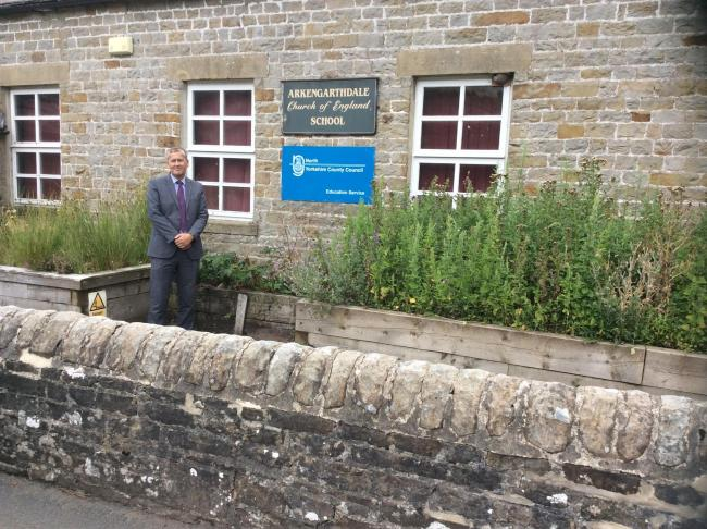 HOMES: Stuart Carlton, Director of the Children's and Young Persons at NYCC outside Arkengarthdale Primary School
