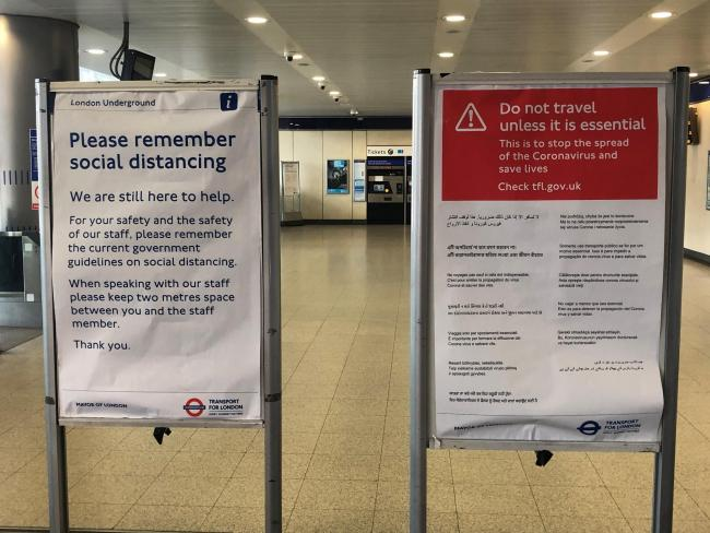 A sign at an entrance to the Underground station at London's Paddington Station warns passengers to exercise social distancing, amidst continuing efforts to fight the coronavirus pandemic. PA Photo. Picture date: Thursday March 26, 2020. See PA story