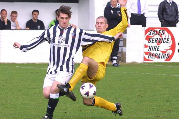 In a 2001 image, Northallerton Town's Neil Preston battles with West Auckland's Neil Johnson Picture: RICHARD DOUGHTY