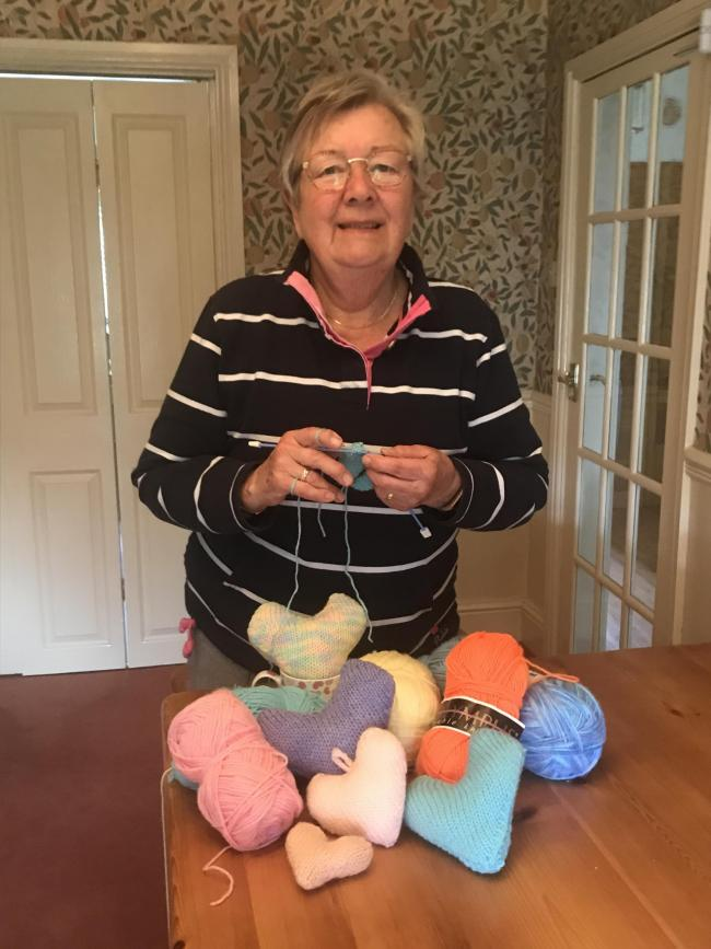 Theatre volunteer, Jen Capewell, knits pantomime hearts from the confines of her home.
