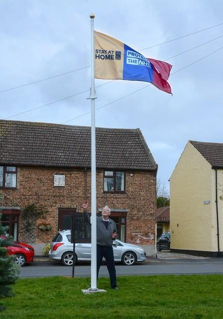 John Weighell and the newly erected NHS flag