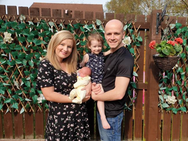 Charlotte Cox, with her husband Anthony and their children Mia, 3, and newborn Jacob at their home in Newton Aycliffe