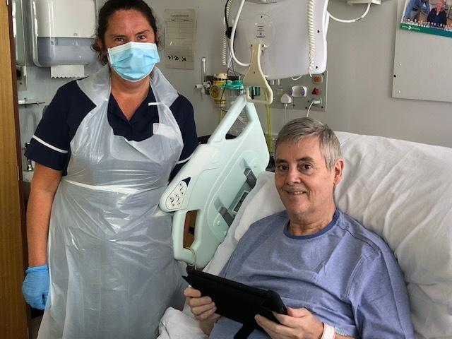 Sister Jane Grieveson with patient Arthur Richardson, at Darlington Memorial Hospital, using a tablet to keep in touch with family.