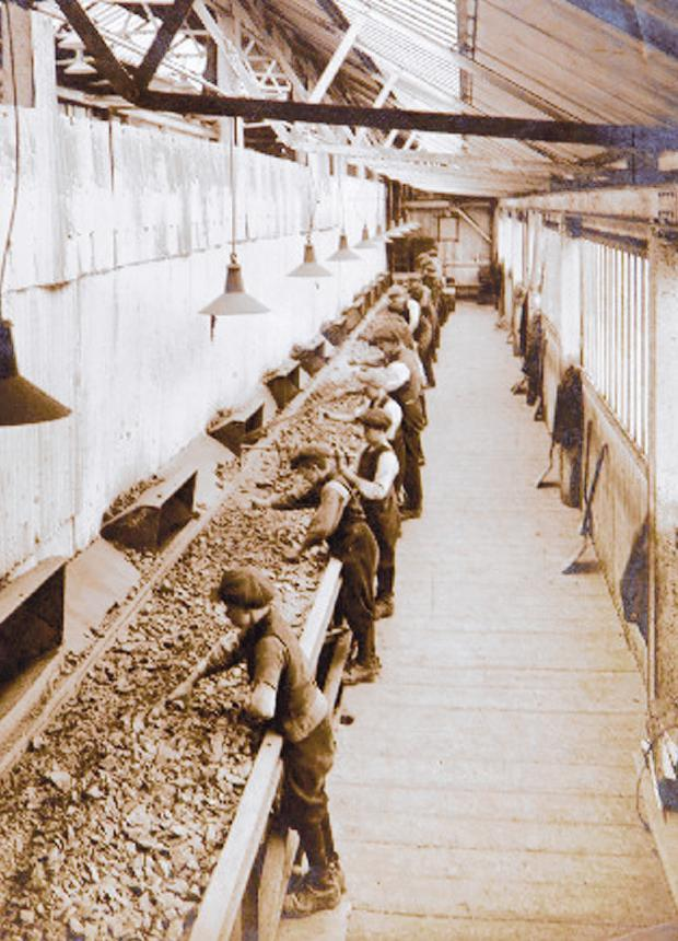 The Northern Echo: BACK-BREAKING WORK: Boys sorting out the ironstone in the Thirties