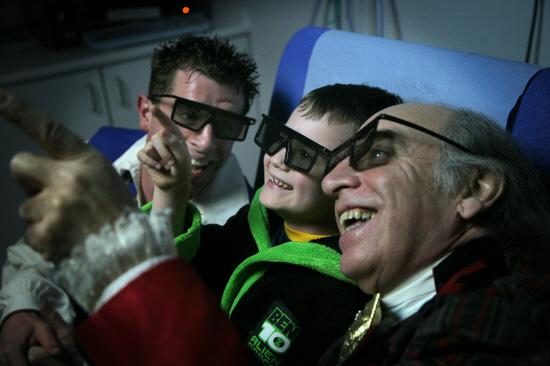 NEW LOOK: Burns patient Adam Sweeney, eight, from Hetton-le-Hole, with panto stars Danny Adams, left, who plays Buttons, and Clive Webb, who plays Baron Hardup, in Cinderella, pictured in the interactive suite