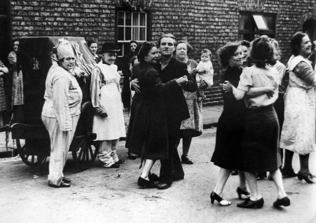 Stan Howes is the nine-month-old babe in the arms of his grandmother at the Brunswick Street VE Day party in the centre of Darlington - it was a largely female gathering because most of the men were away on active service.