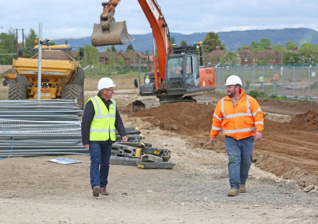 Cllr Mark Robson is pictured with site manager Matt Perverall
