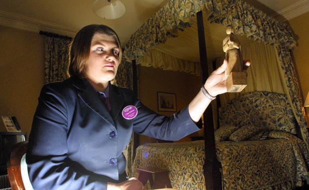 The Northern Echo: Clare Robson pictured in 2003 with the wooden statue of the nun in the haunted bedroom at the Hall Garth Hotel, Darlington