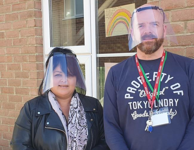 Elaine Fenwick and Craig Raine model the visors made on a 3D printer at Delta North in Consett, which are being distributed to key workers and frontline organisations within the community