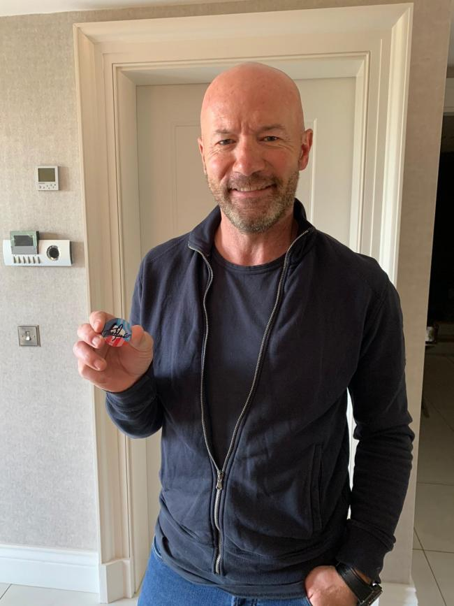 Alan Shearer with the signed badge