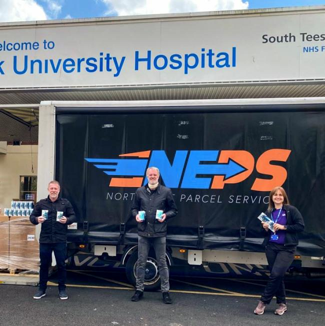 Craig Hignett, Gary Pallister and Julia Dobson delivering the drinks to South Tees Hospital